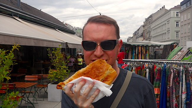 Eating a börek at the Naschmarkt