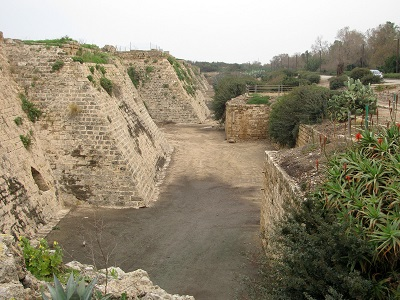 Crusaderwalls: the massive walls and moat built by the Crusaders enclose the port part of the city