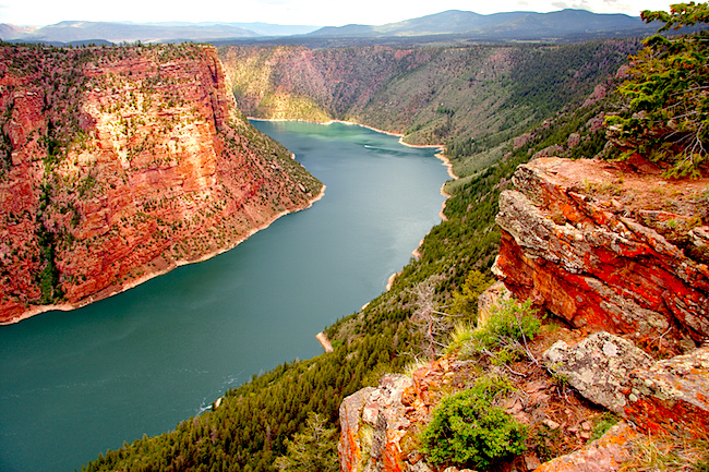 Flaming Gorge Reservoir - a National Recreation Area on the Green River Note orange and red lichens growing on foreground rocks