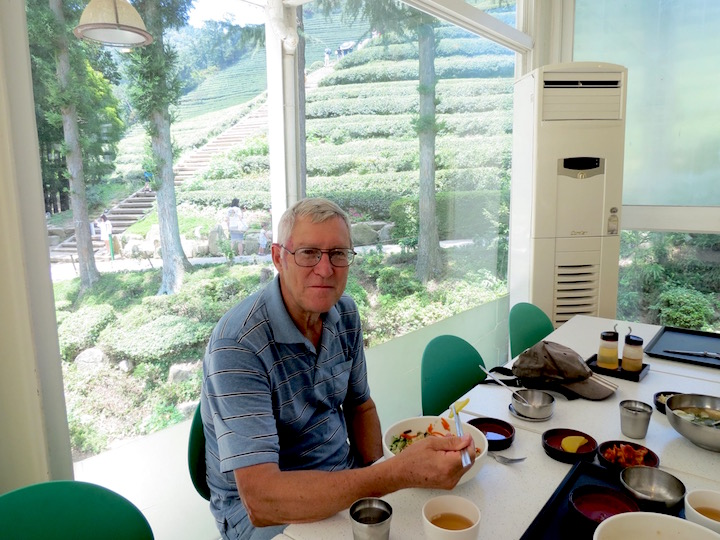 the author's husband enjoys lunch at the café, with the most amazing view