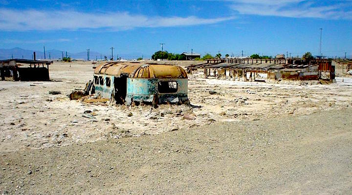 Abandoned, salt-encrusted structures on the Salton Sea shore at Bombay Beach