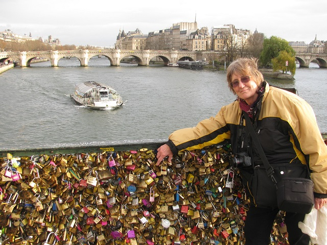 Viv M points out some of the locks, with a lovely view of the River Seine behind