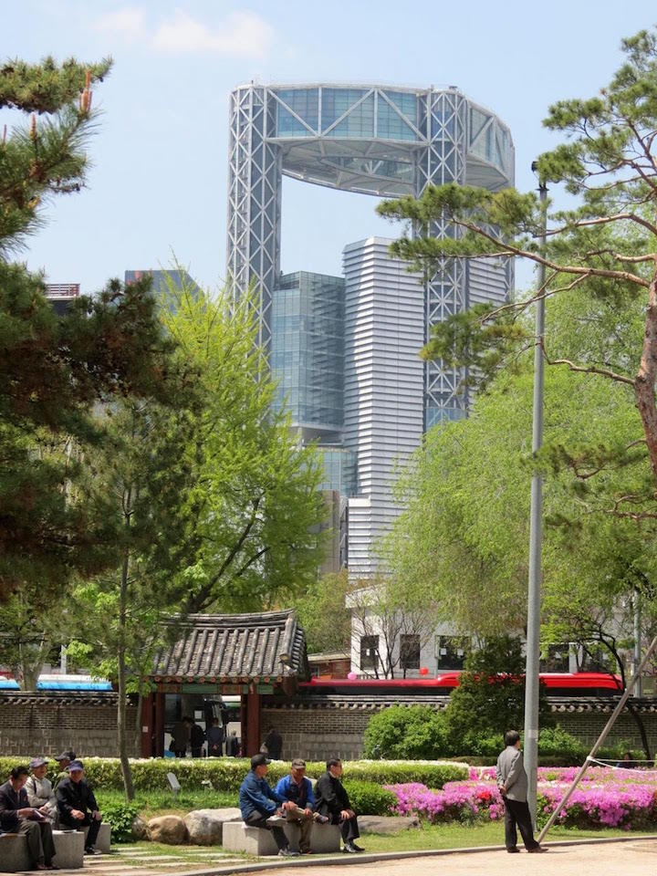 oldnew: an old gateway into Tapgol Park is dwarfed by the amazing, modern Jongno Tower